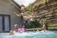 Happy family having fun in swimming pool - KNTF00931