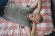 Relaxed mature man sleeping on bed - ALBF00273