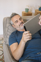 Relaxed mature man at home using tablet - ALBF00279