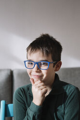 Portrait of smiling boy wearing blue glasses - ALBF00292