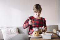 Portrait of girl preparing batter - ALBF00295
