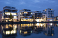 Germany, North Rhine-Westphalia, Dortmund-Hoerde, Phoenix Lake, Residential houses, blue hour - WIF03460
