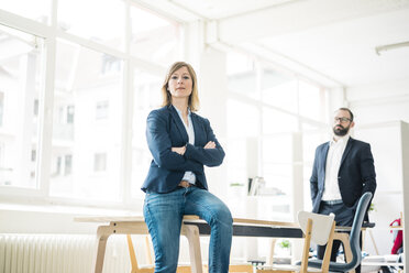 Portrait of confident businesswoman and man in office - JOSF01917