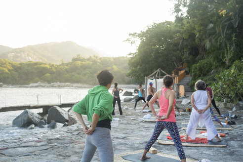 Mexico, Mismaloya, yoga class at ocean front - ABAF02184