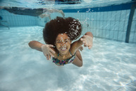 Girl swimming under water in swimming pool - MFF04167