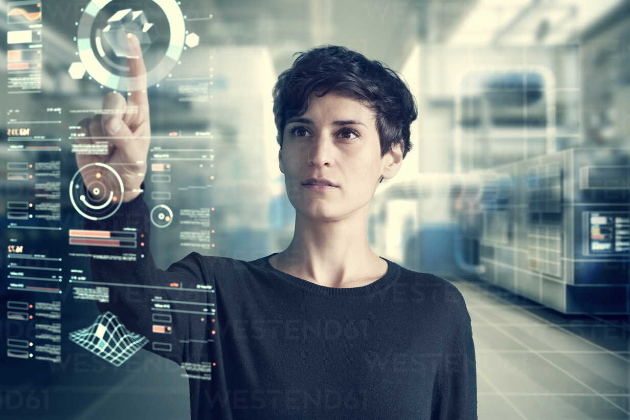 Young woman using transparent touchscreen display, Composing - RBF06166 - Rainer Berg/Westend61