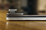 Stack of mobile devices on table top - MFF04222