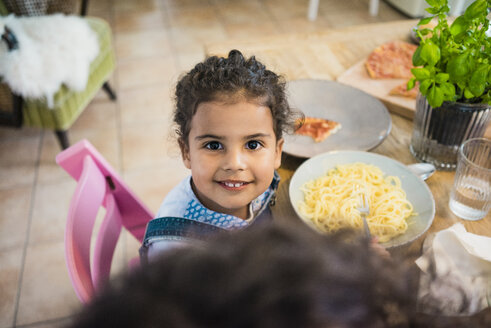 Portrait of a cheeky little girl eating spaghetti - MOEF00338
