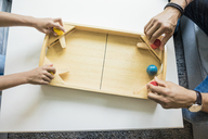 Father and daughter playing foosball, overhead view - MOEF00398