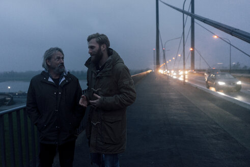 Father and son meeting on bridge, discussing business - KNSF02877