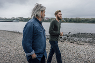Father and son taking a stroll at Rhine river, meeting to talk - KNSF02907