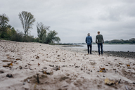 Father and son taking a stroll at Rhine river, meeting to talk - KNSF02913