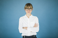 Portrait of smiling businesswoman with glasses - JOSF01973