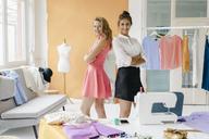 Portrait of two confident young women in fashion studio - KNSF02968