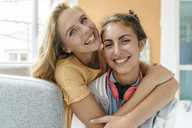 Portrait of two happy young women hugging - KNSF03037