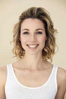 Portrait of blond woman wearing tank top, smiling - PNEF00360