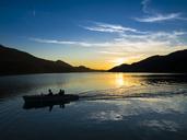 Austria, Upper Austria, Salzkammergut, Lake Fuschlsee, boat at sunset - AM05535