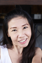 Portrait of smiling dark-haired woman - IGGF00214