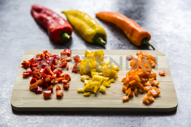 Chopped pointed peppers on wooden board - SARF03412