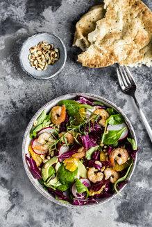 Lamb's lettuce, radicchio, shrimp, red radish, orange, pine nut, rosemary, avocado in bowl - SARF03417