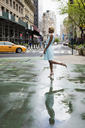 USA, New York, young blonde african-american woman standing on one leg - MAUF01245