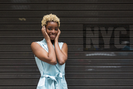 USA, New York, happy young blonde african-american woman, smiling, hand on head - MAUF01254
