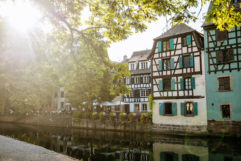 France, Strasbourg, half-timbered houses at river III at sunset - KIJF01728