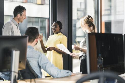 Business people having a meeting in office - UUF12395