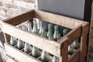 Empty bottles in a wooden crate - GUSF00176