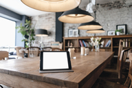 Digital tablet on a table in a cafe - GUSF00245