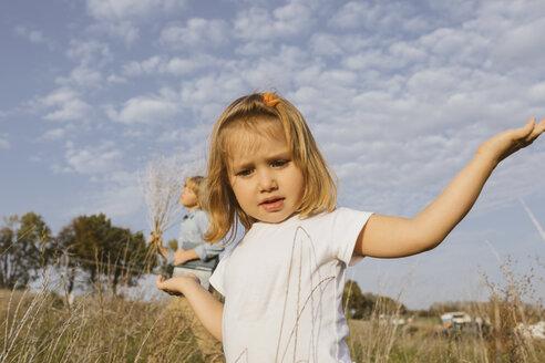 Portrait of blond little girl in nature - KMKF00071