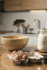 Wooden bowl, brown eggs and flour for preparation of dough - MAUF01258