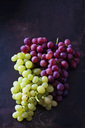 Blue and green grapes on dark metal - CSF28577