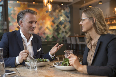Two business people having lunch in a restaurant - SUF00349