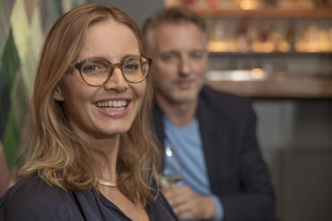 Portrait of laughing woman in a wine bar - SUF00373
