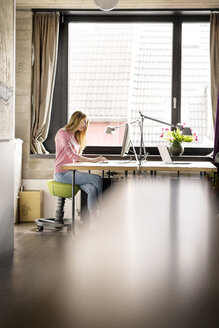 Woman working at desk at home - PESF00763