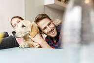 Happy young couple with dog at home - PESF00784