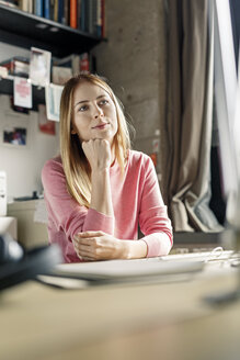 Portrait of young woman working at desk at home - PESF00880