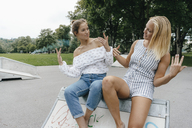 Two happy young women in a skatepark - KNSF03079