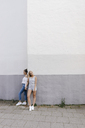 Two young women standing at the corner of a building - KNSF03097