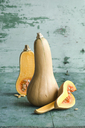 Whole and a sliced butternut squashes - ASF06128