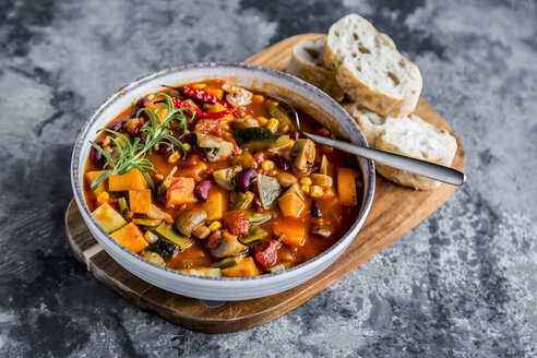 Vegetable chili with kidney bean, sweet potatoe, champignon, corn, snow pea, baguette in bowl - SARF03441