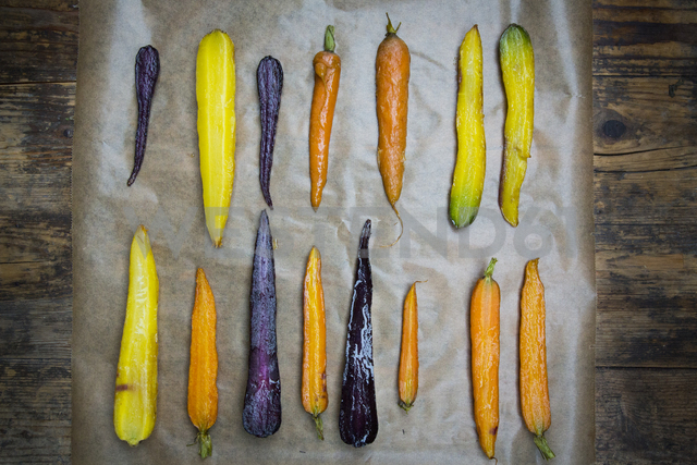 Oven winter vegetables, carrot, beetroot,  and parsnip on baking paper - LVF06480