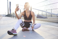 Fit woman taking selfie after outdoor workout - BSZF00114