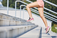 Close-up of woman running on stairs - BSZF00123