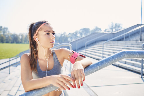 Young woman resting after outdoor workout in the city - BSZF00129