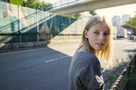 Portrait of blond young woman watching something - KNSF03139