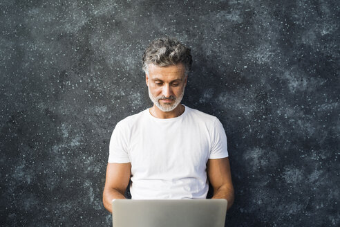 Mature man using laptop - HAPF02452