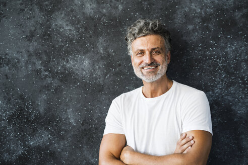 Portrait of a mature man, smiling, looking at camera - HAPF02455