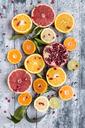 Various citrus fruits, orange, tangerine, grapefruit, lime, lemon and pomegranate - SARF03445